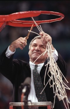 5 APR 1993: University of North Carolina head coach Dean Smith cuts the last loop of the net after his team defeated Michigan 77-71 earning North Carolina the championship title at the Superdome in New Orleans, LA. Rich Clarkson/NCAA Photos
